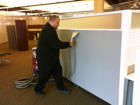 Randy Cleaning Panels in the Intereum Showroom